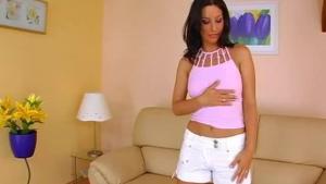 Lovely brunette milf licking a pink dildo