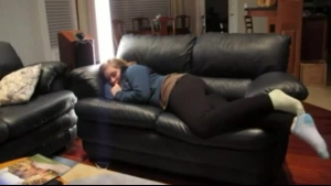 MILF dreams of turning on her husband with a big, hard dick while on the black sofa